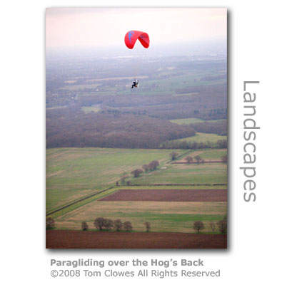 Paragliding over the Hog's Back by Tom Clowes